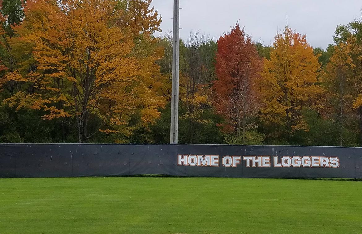 Phillips, WI baseball field fence with Home of the Loggers